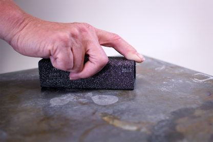 GlazeEraser Hand Tool for cleaning rough pot bottoms and Advancer kiln shelves.